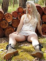 Sunday likes her wood fresh and smelling good. Lolling around in the sun, she looks devine drenched in golden light, dreadlocks flowing, and touching her moist pussy.